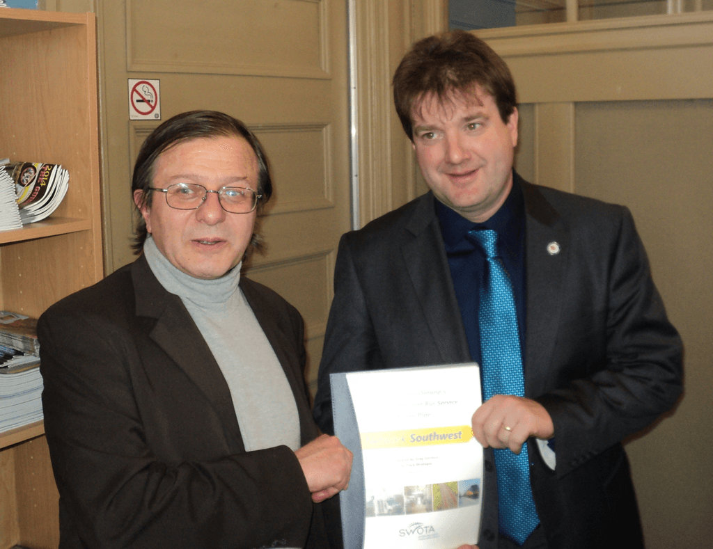 Greg Gormick presents the Network Southwest report to Al Strathdee, Mayor of the Town of St. Marys